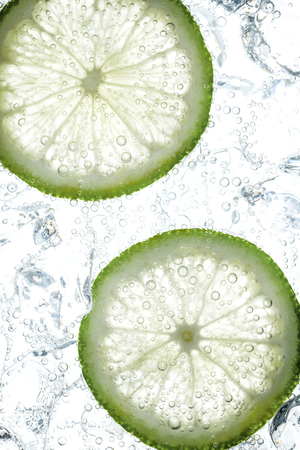 closeup view: fresh lime slices in soda Stock Photo