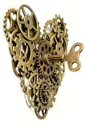 heart gear: gear heart with key on white Stock Photo