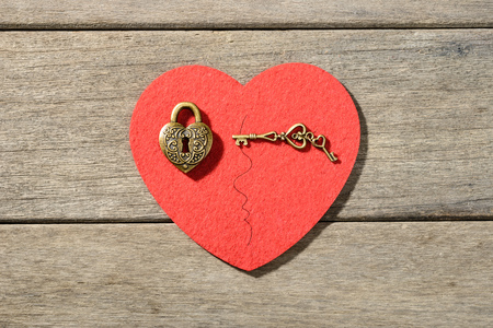 lock: bronze heart shape lock and key Stock Photo