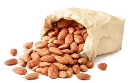 dried almonds in paper bag Stock Photo
