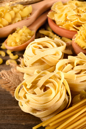 dried pasta and wheat on the wooden board