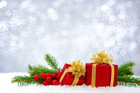 xmas background: xmas gift box on the shiny background Stock Photo