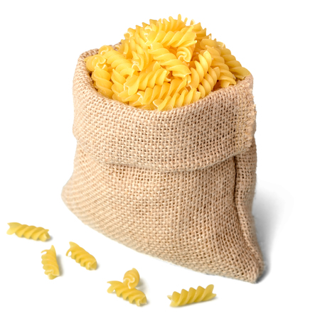uncooked: uncooked fusilli pasta in sack Stock Photo