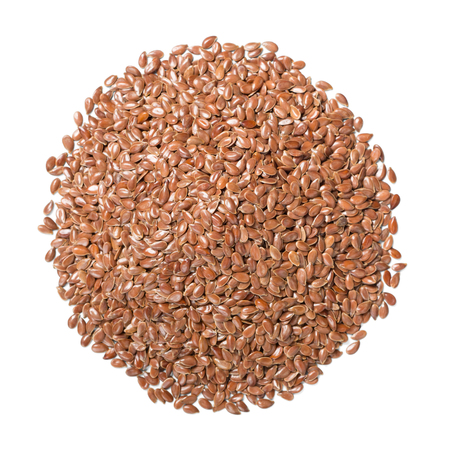 dried flaxseeds on white