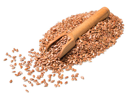 uncooked flax seeds in the wooden spoon