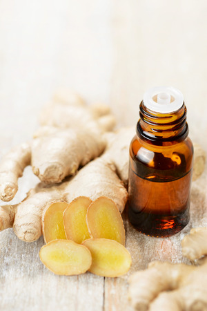 Ginger essential oil in the amber bottle