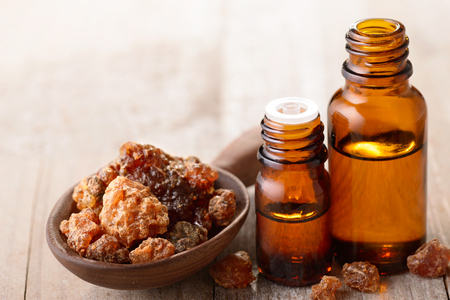 myrrh essential oil on the wooden board Banco de Imagens