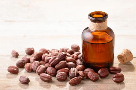 Jojoba oil in the glass bottle