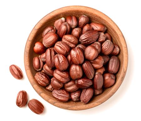 dried jojoba seeds isolated on white Foto de archivo