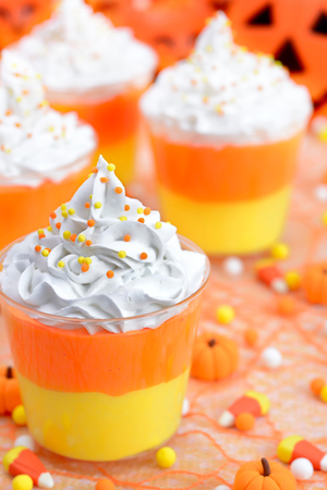 Halloween candy corn puddings for the party Stock Photo