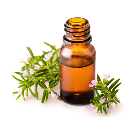 rosemary essential oil isolated on white Foto de archivo