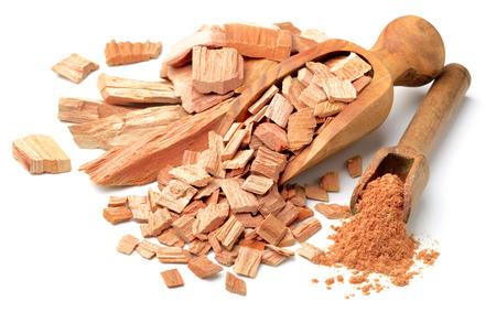 sandalwood slice and powder in the scoop Foto de archivo
