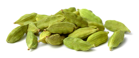 dried cardamom seeds isolated on white Standard-Bild