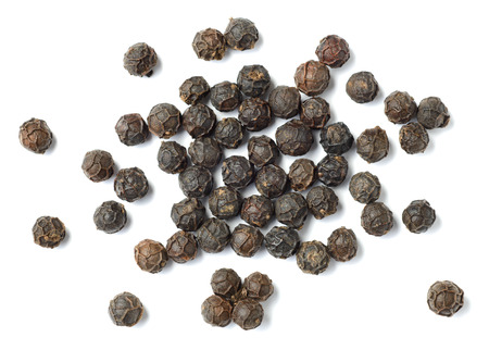 dried black peppercorns isolated on white, top view.