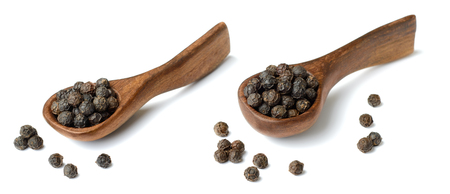 dried black peppercorns in the wooden spoon, isolated on white Stock Photo