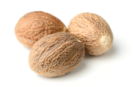 closeup of nutmeg spice isolated on white