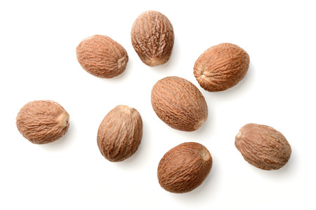 dried nutmeg isolated on white, top view