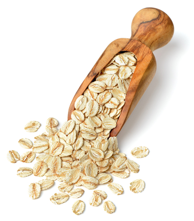 raw oatmeal in the wooden scoop, isolated on white background