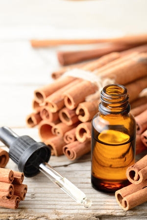 cinnamon essential oil in the glass bottle