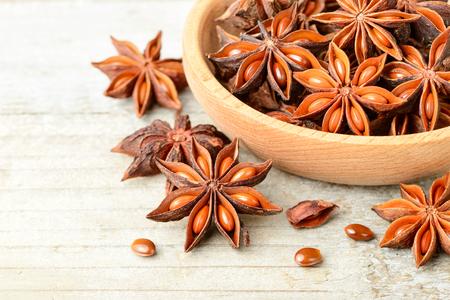 star anise fruits on the wooden board Standard-Bild