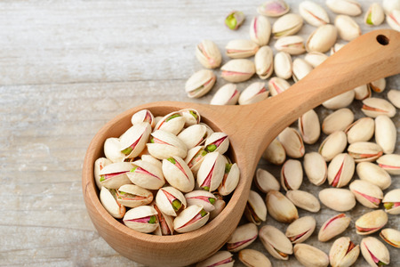 pistachio nuts with shell on the wooden board