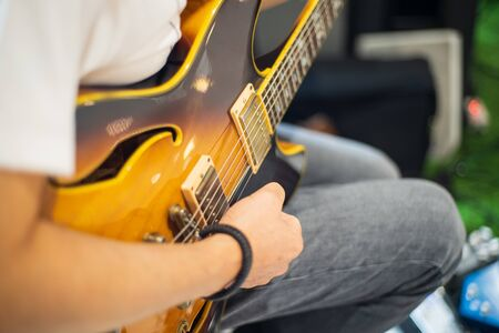 Hands and Electric guitars of young guitarists playing guitar concepts