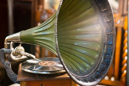 Retro old gramophone radio. Vintage aged turquoise gramophone phonograph turntable