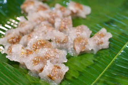 Saku Sai Moo. Thai dessert food Steamed Tapioca dumpling sago balls with pork on A banana leaf
