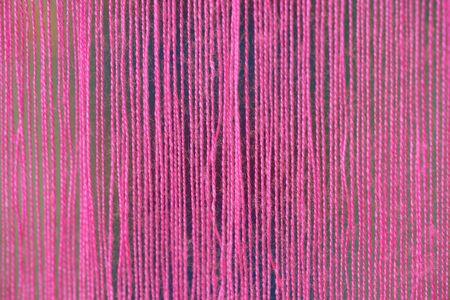 pink thread linen fabric background texture Close up
