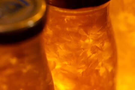 Close up Fresh natural Fruit meat with juice in glass bottle