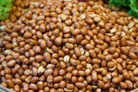 close up Roasted peanuts at thailand street food market 写真素材