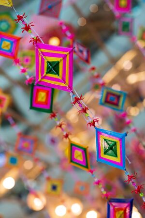 Thread and Beads handmade hanging mobile decoration with copy space Фото со стока