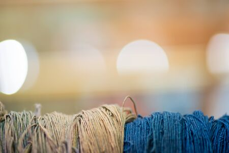 Close up thread linen fabric on Bokeh Light background with copy space