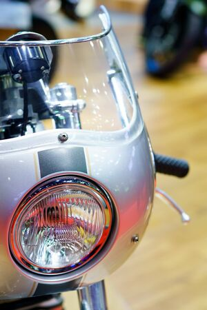 motorcycle headlight Close up. Detail of a motorcycle headlight Foto de archivo - 129807790