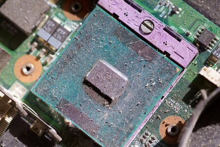 Close-up computer Processer Electronic Chipset on Motherboard is covered with dust