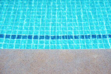 Rippled surface of Swimming pool blue water sun reflecting sleek background Stock Photo