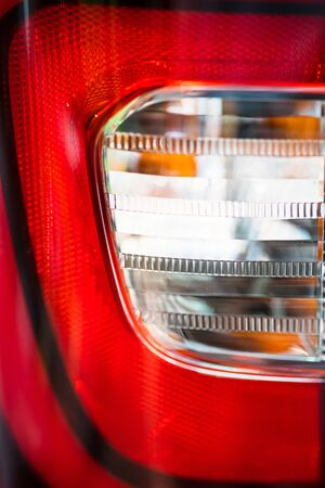 abstract blurred Close up Color detail on the Rear front light of a car