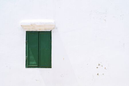 green wooden closed window On a white wall house