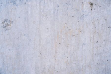 Old grey concrete wall grunge texture background close up