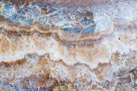 Rusty brown stone surface texture background close up