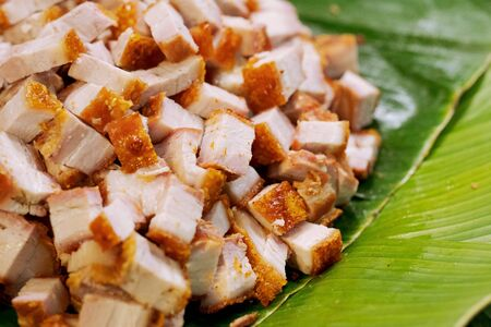 crispy pork belly or deep fried pork, thai street food market Фото со стока