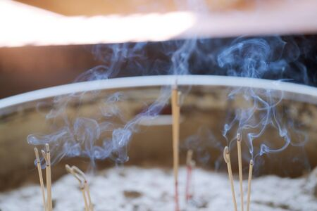 Close up of Burning Incense Sticks in the temple