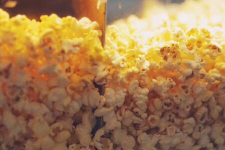 Close up of popcorn machine at the cinema texture background Фото со стока