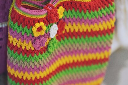Fashion Colorful crochet bag handmade texture background Фото со стока