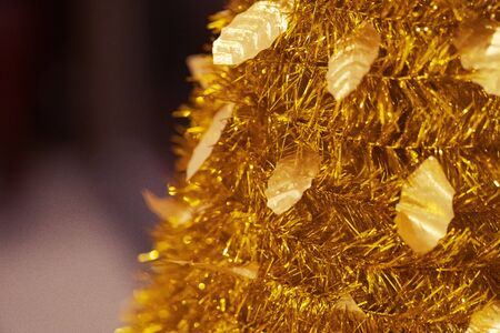gold Decoration of artificial chrismas tree and New year festival background