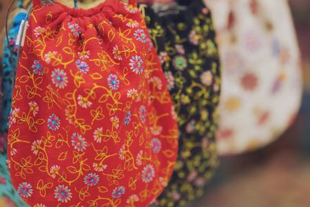 Close up of Handicrafts embroidered bag with traditional pattern texture background