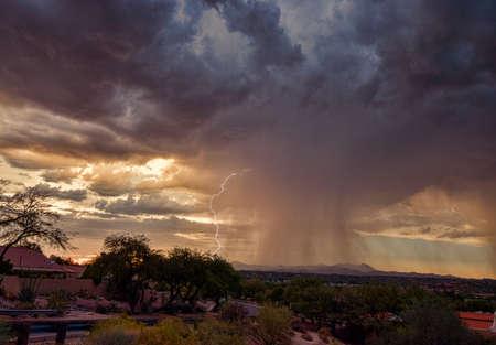 Monsoon storm, lightning, and sunset Stock Photo