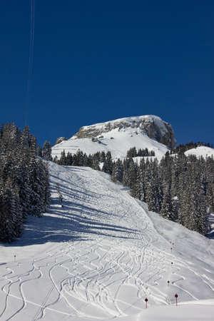 deep powder snow: Empty ski slope with powder snow under mount  Hoher Ifen