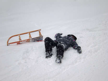 deep powder snow: Girl fell from her sled while tobogganing at Imberger Horn in the German Alps