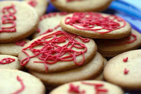 bickie: Christmas gingerbread cookies decorated with red icing Stock Photo